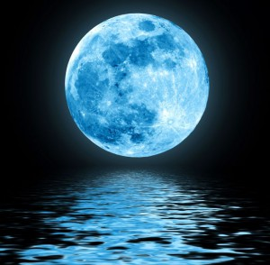 11772372 - full blue moon over water with reflections